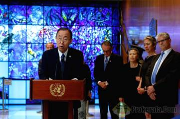 UN Secretary-General Ban Ki-Moon (front) speaks after he laid a wreath in memory of the second UN ...